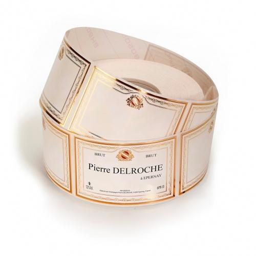 Rouleau d'étiquettes rectangulaires crème avec un liseré or sur les contours