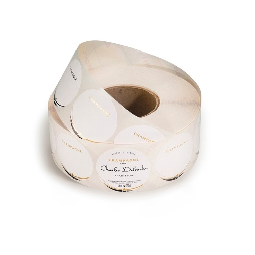Rouleau d'étiquettes rondes blanches avec un liseré et une étoile or