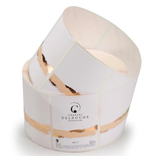 Rouleau d'étiquettes rectangulaires blanches avec une bande or à chaud